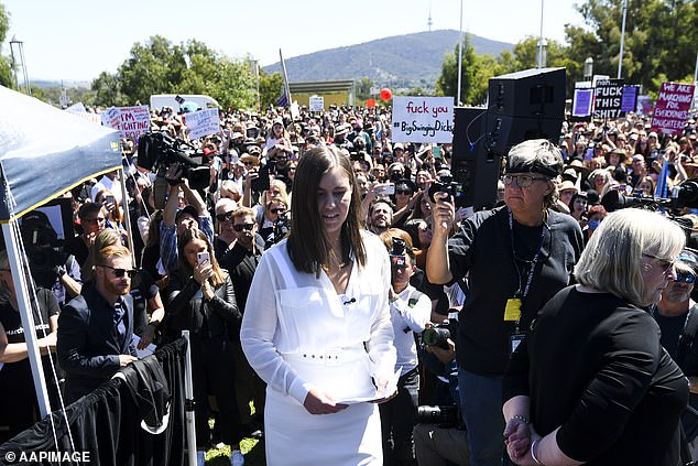 Speaking out: It comes after Brittany Higgins (pictured in white), a political adviser to the Liberal Party, came forward with allegations that she had been raped inside the parliament building in 2019 - saying she had been 'silenced' by party officials