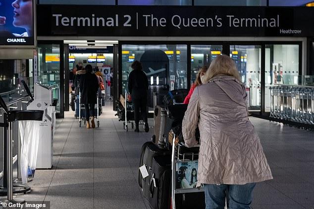 Passengers make their way to the departure gates at Heathrow's Terminal 2