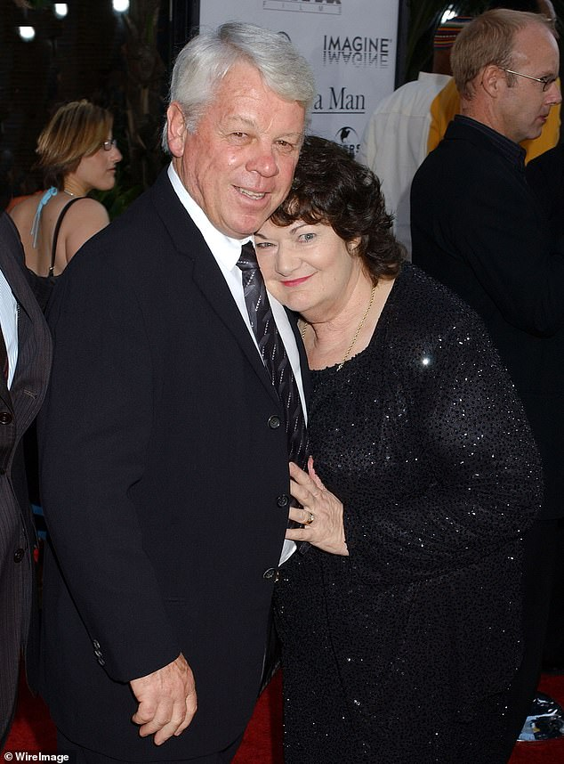 Family ties: Johnis survived by wife Jocelyn (pictured together in 2005) and sons Terry and Russell. The pair previously worked as caterers on film sets - no doubt inspiring for Russell who later carved out a career in Hollywood