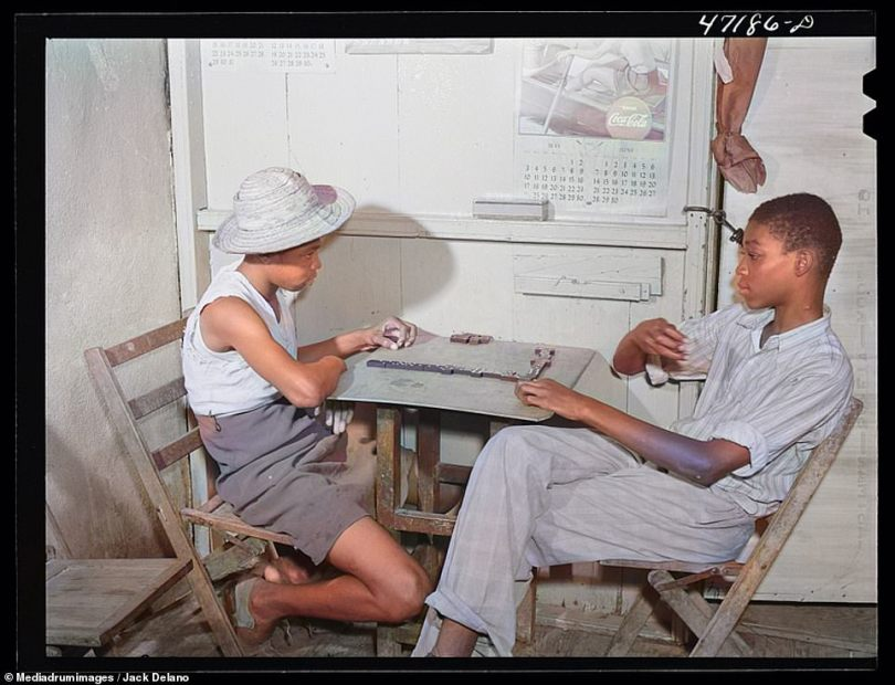 An intense game of dominoes is depicted in this photograph from 1941. Two young boys face off against one another from across a small wooden table inside a candy store in Charlotte Amalie, Saint Thomas Island, Virgin Islands, in 1941. One of the oldest known pastimes, dominoes can trace its origins back to China around 1120 AD, though some in China believe it was invented as early as 181 AD by a hero named Hung Ming as a way of entertaining his soldiers