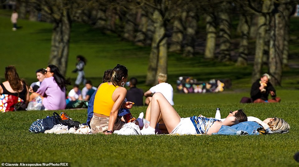 It comes as lockdown-weary Britons head to beaches and parks to sizzle on hottest day of the year and enjoy their newfound freedoms (pictured in Hyde Park)