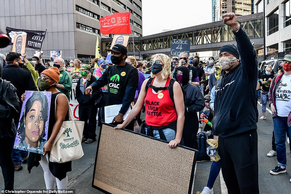 Hundreds of people gathered outside of the Hennepin County Courthouse on Monday