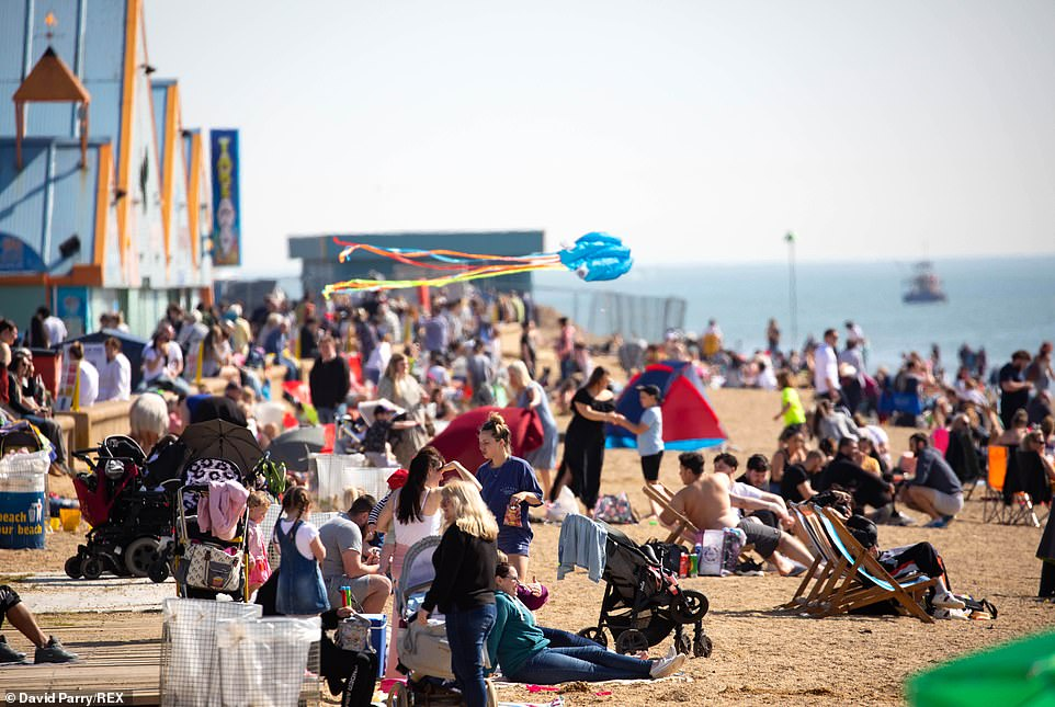 Beachgoers enjoy the sun at Southend-on-Sea this afternoon as a mini heatwave hits the South East of England