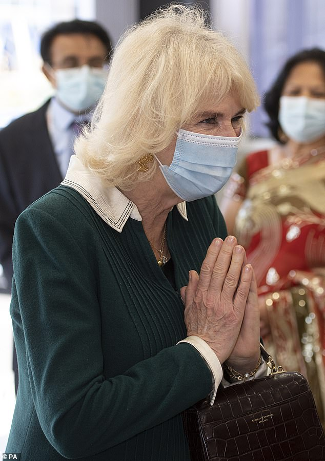 The Duchess of Cornwall performed a namaste bow as she met with frontline workers during a visit to a pharmacy in East Sussex earlier today
