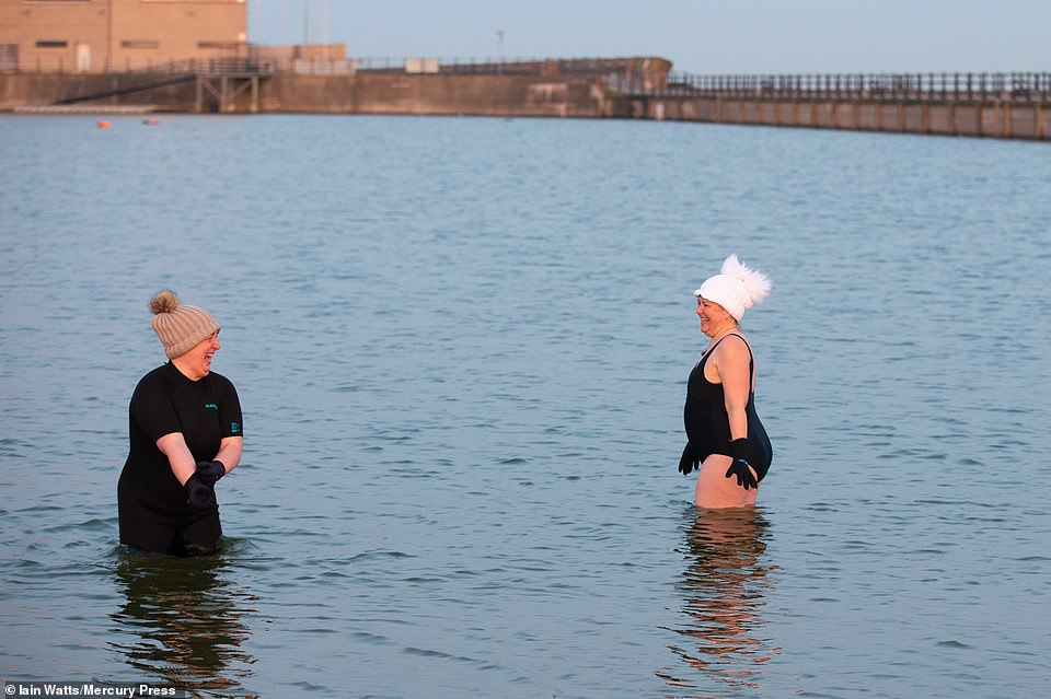 Early morning swimmers brave the cold water in New Brighton marina in the Wirral this morning