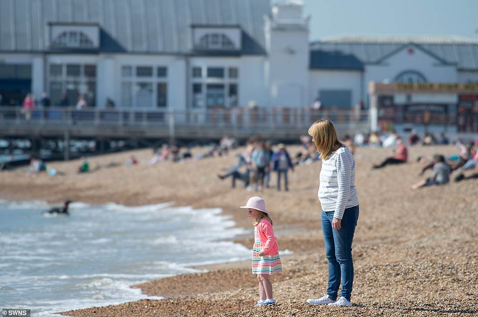 Families make the most of the warm weather conditions at Southsea this afternoon
