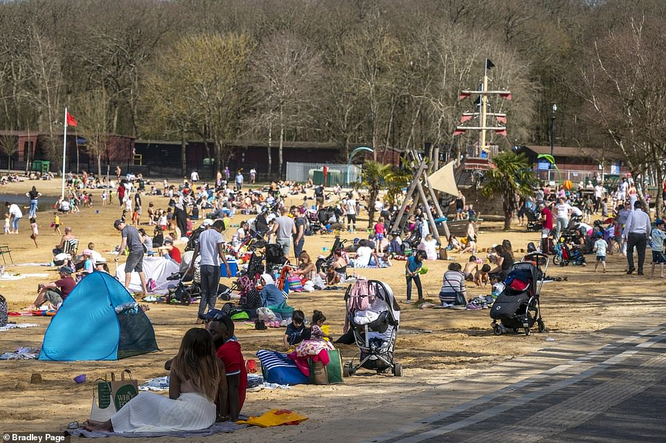 People enjoying the warm weather at Ruislip Lido in North West London this afternoon