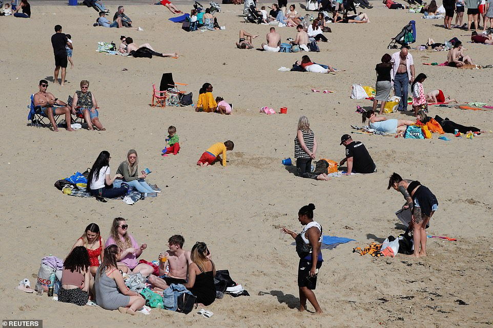People enjoy the hot weather at Bournemouth beach on the Dorset coast this afternoon