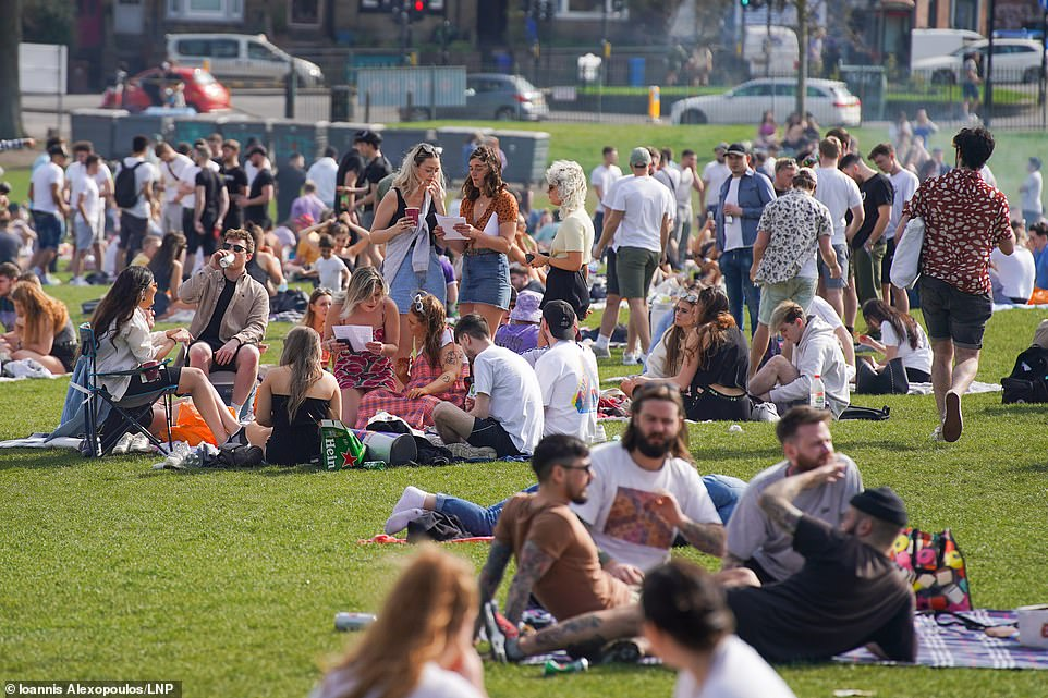 People gather at Endcliffe Park in Sheffield this afternoon as parts of England enjoy unseasonably high temperatures today
