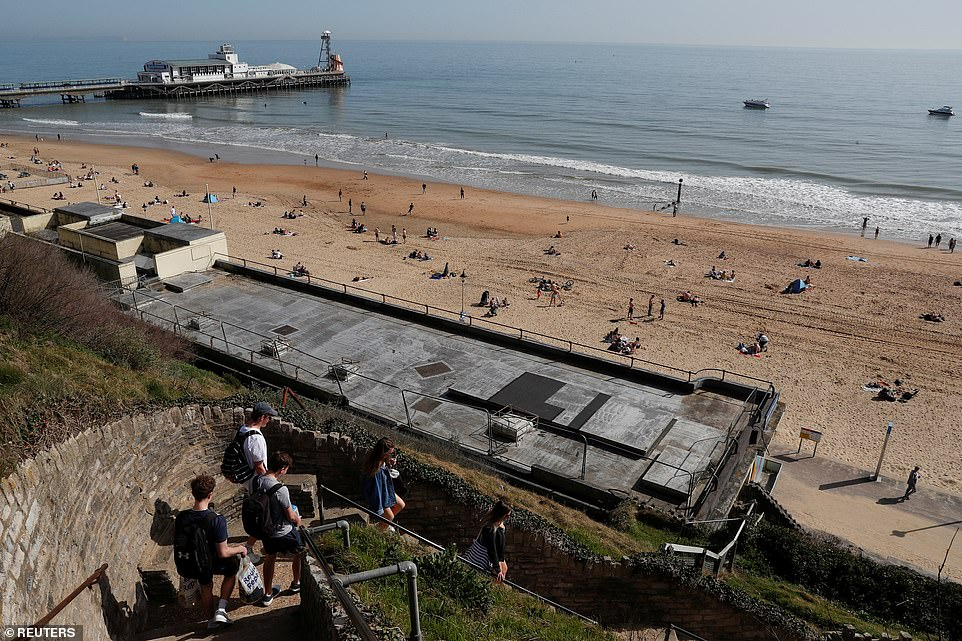 People enjoy the hot weather at Bournemouth beach in Dorset this afternoon