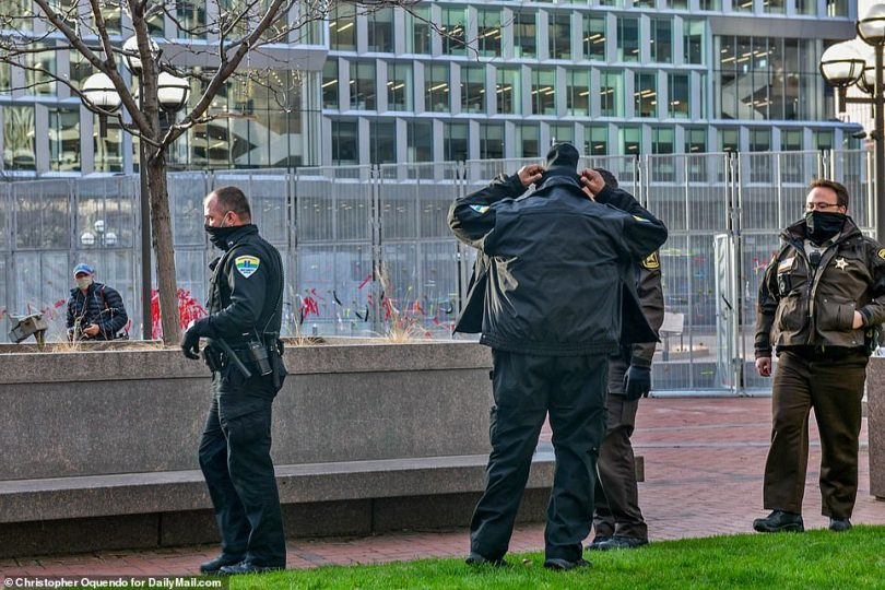 Law enforcement officers are seen outside the Hennepin County Courthouse on Tuesday morning