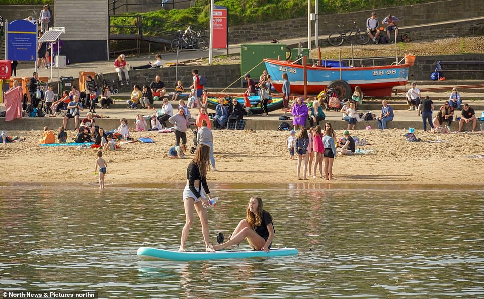People out enjoying the hot weather at Cullercoats Bay in North Tyneside this afternoon