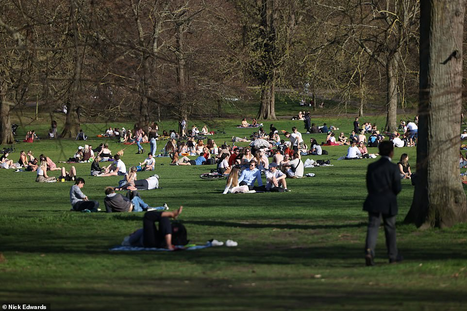 People out in the sunny weather at Greenwich in South East London  this afternoon amid the hot conditions