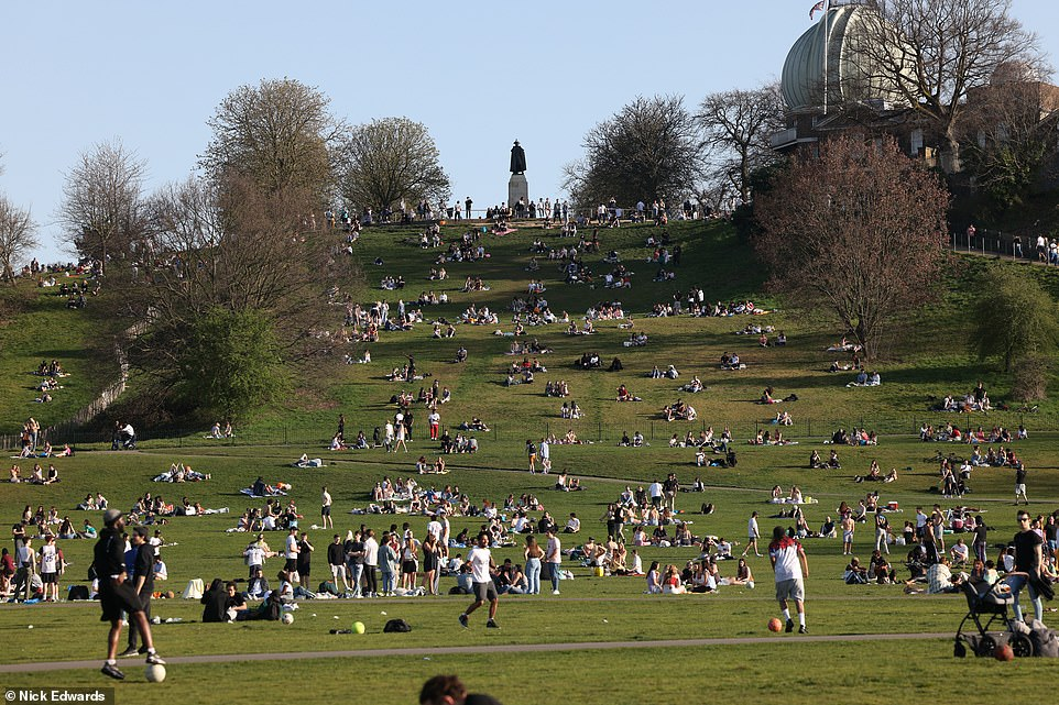 Groups were gathered on a hill in Greenwich, London, today as they enjoyed the warm weather. Groups of six - or two full households - are allowed to meet up outside