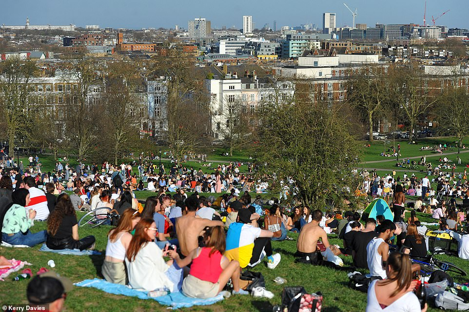It comes as a major Office for National Statistics testing survey today revealed 54.7 per cent of people in England had the virus-fighting proteins in the week ending March 14, up from 50.8 per cent the week prior. Pictured: People having picnics on Primrose Hill, London