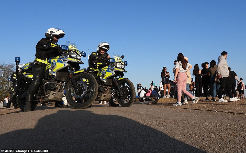 Police officers  were seen in Primrose Hill today. Health Secretary Matt Hancock earlier shared a Tweet urging Britons to 'enjoy the sun but let's do it safely', adding: 'We have come so far, don't blow it now'