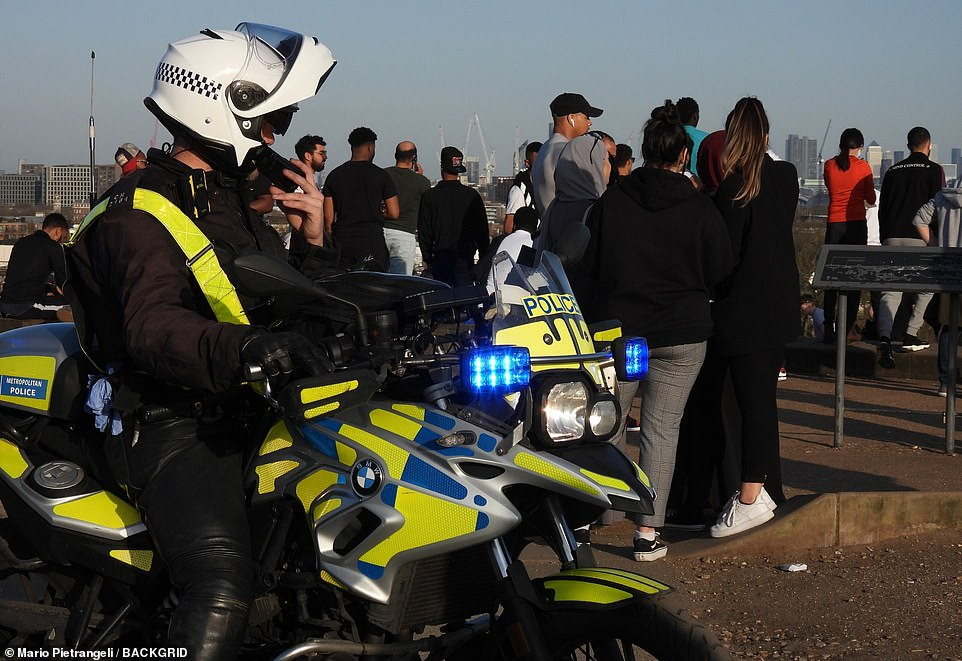 A large number of police officers arrived at Primrose Hill today where Londoners were taking advantage of the warm weather