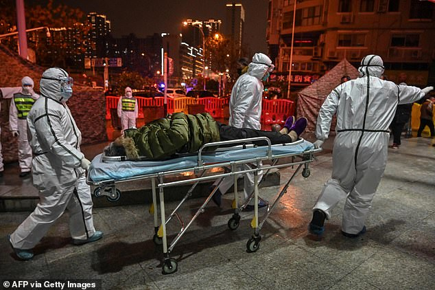 But this pandemic has proven the WHO is not up to the job without major reform. Pictured: Medical staff outside the Red Cross Hospital in Wuhan in January 2020