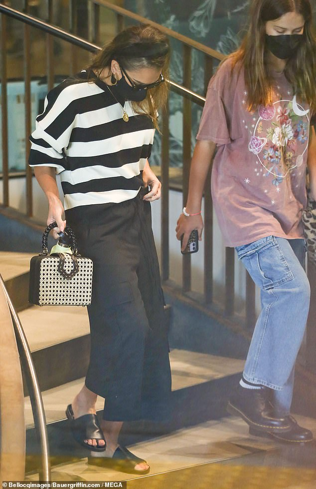 On the go: The pair was seen heading to their parked car during their day together