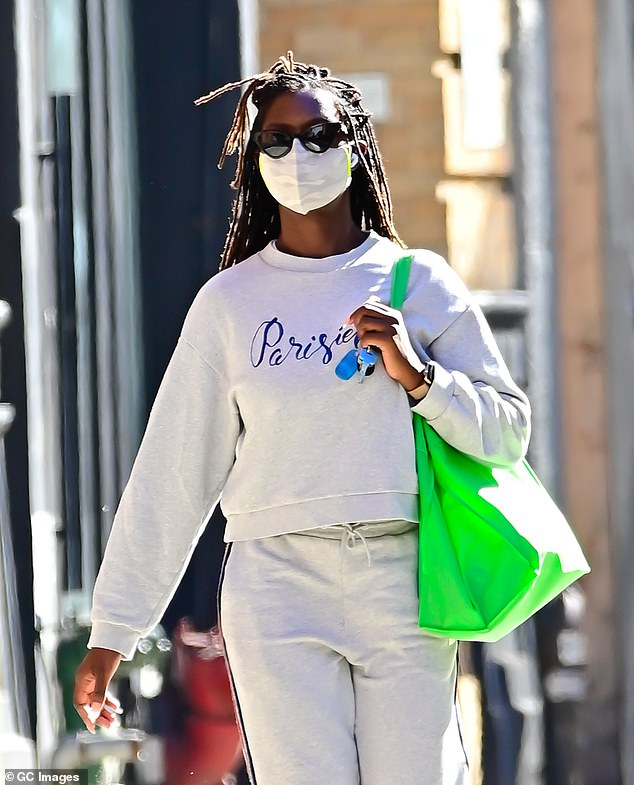 Errand: Her long braids were styled back from her face and she sported a pair of sunglasses