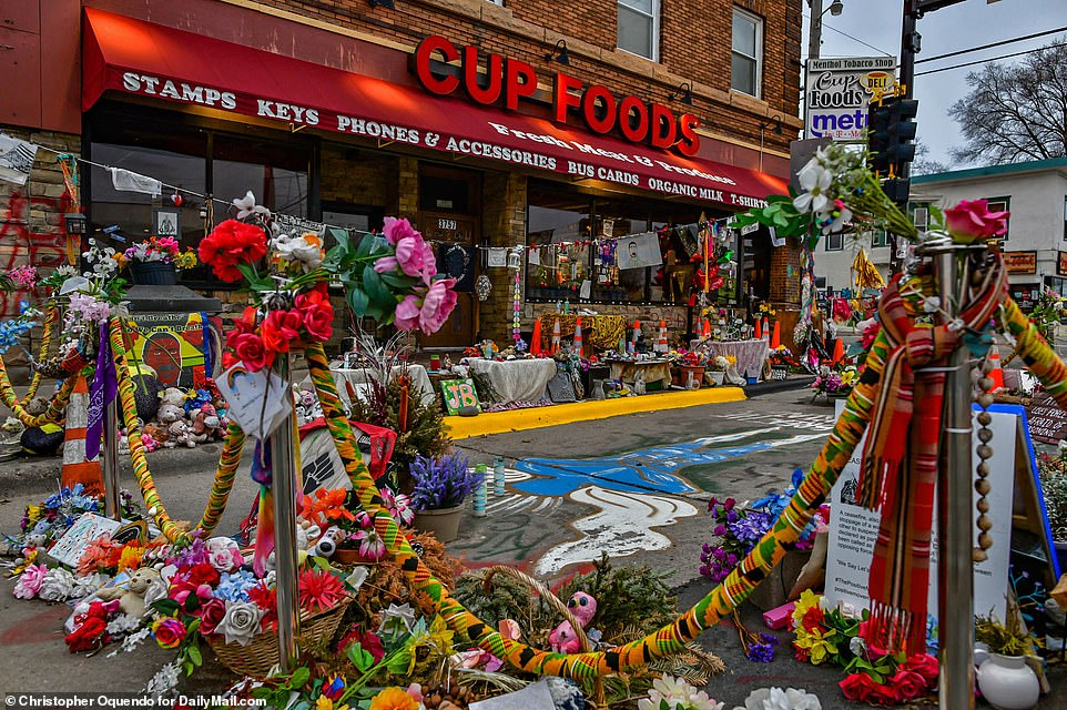 The image above shows a makeshift memorial for Floyd at the spot of his fatal arrest last May
