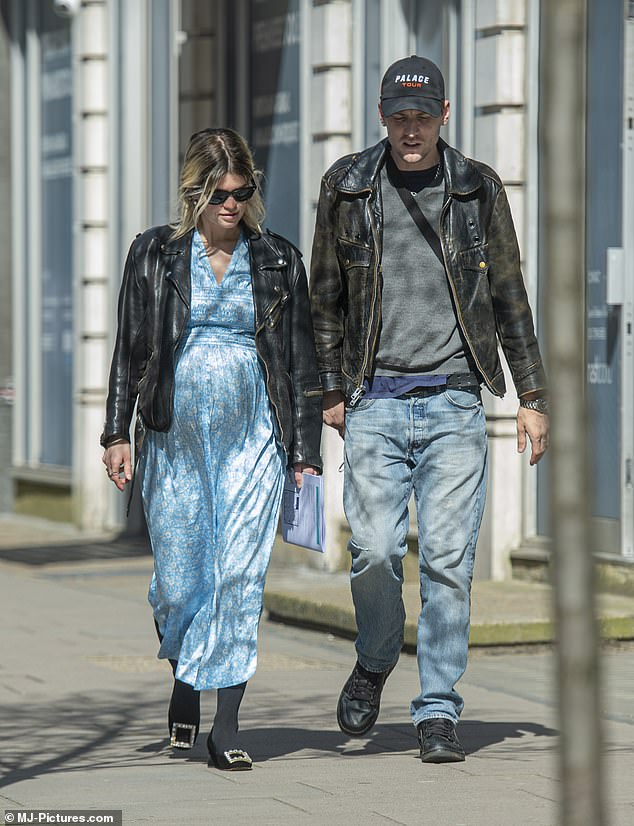 Loved-up: Pixie and George, 32, appeared to be making the most of the glorious sunshine as they stepped out for a walk