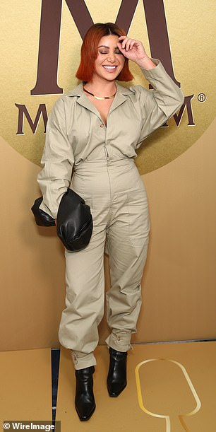Ready to work: Martha also stepped out in a taupe-coloured boiler suit, which featured a cinched in waist, button-up shirt and loose-fitting pants