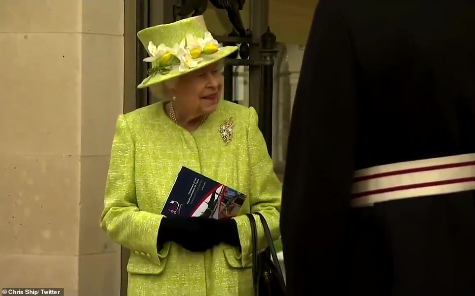 The Queen wore a spring-inspired ensemble for the occasion, donning a green coat and matching hat, adorned with faux daffodils and orchids
