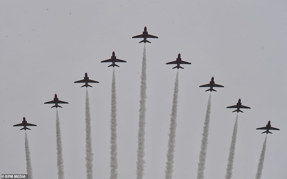 The ceremony began with a flypast by the Red Arrows, but with white smoke only instead of the familiar red, white and blue. As they do not normally perform at this time of year, their smoke pods are in for maintenance