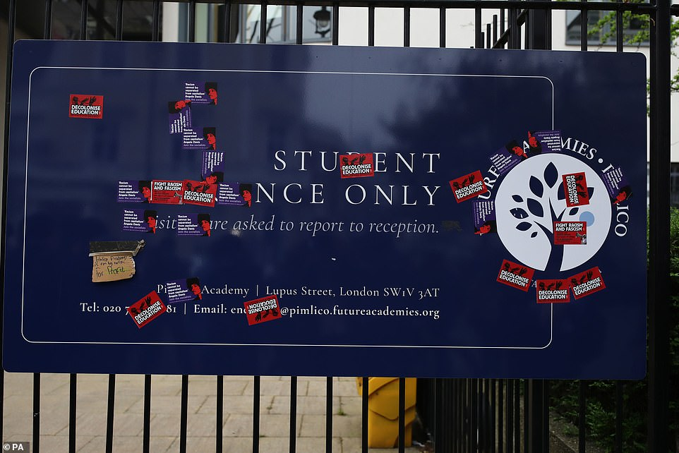 A sign covered in anti-fascism and anti-racism stickers outside Pimlico Academy School prior to Wednesday's mass protest. It was cleaned yesterday