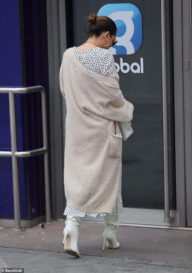 Strut:Looking in good spirits on her outing, Myleene wrapped up in a cream cardigan while she also sported a pair of gold hoop earrings