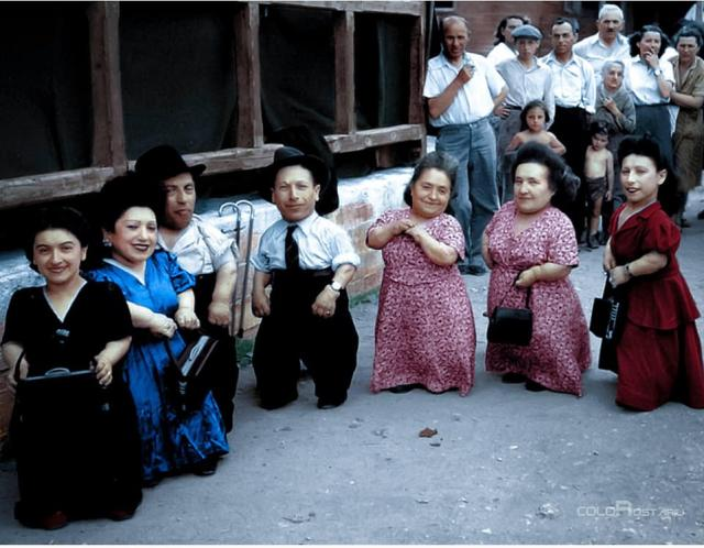 Among the prisoners forced to perform were the Ovitz family, seven of whom were born with dwarfism and toured in a vaudeville show before being sent to Auschwitz. Pictured: A colorised photo of the Ovitz family, L-R: Rosika, Franzisca, Avraham, Markus, Frida, Elizabeth and Pualina taken in Israel in 1949