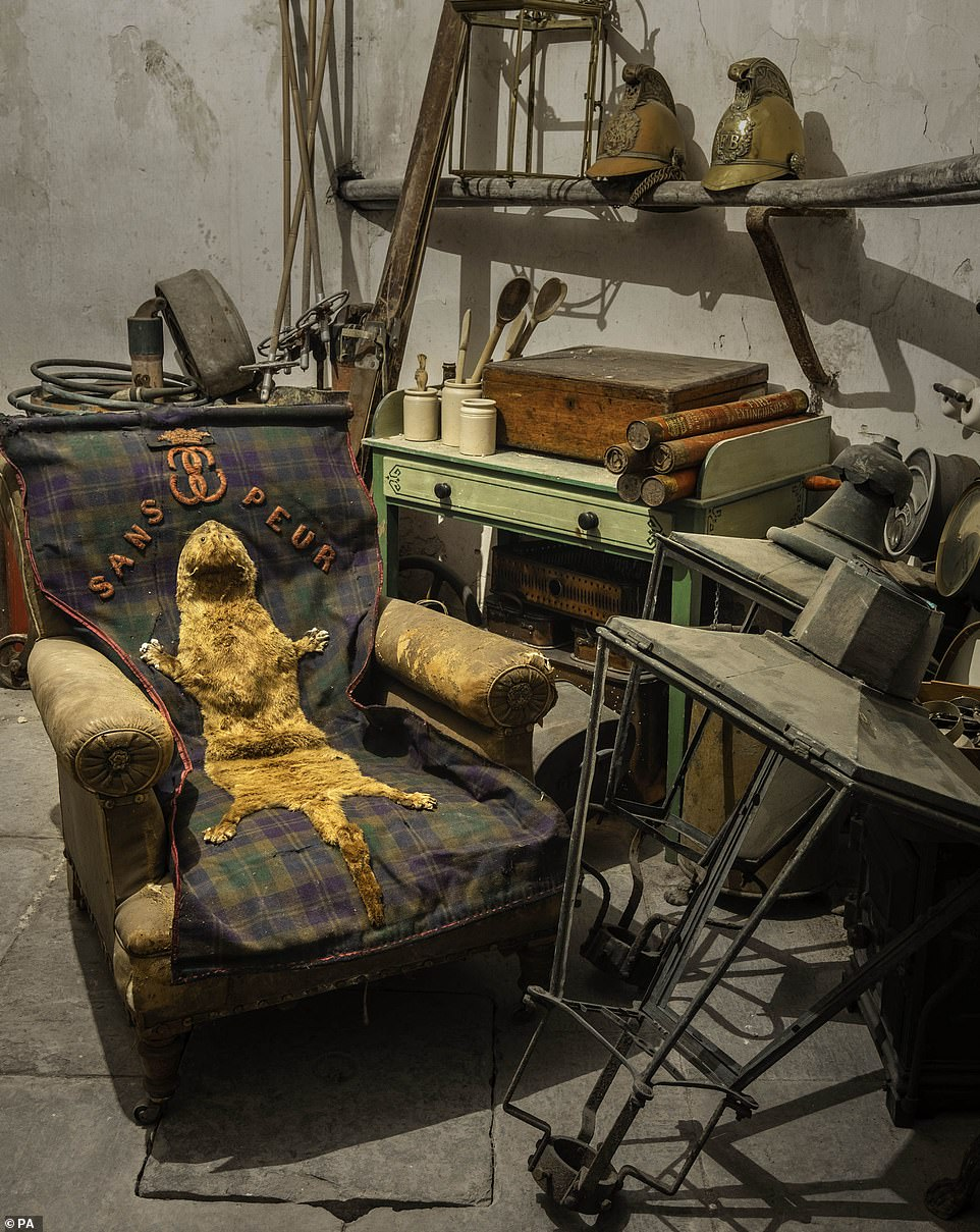 Images released by Bonhams show furniture and household items were found inside the castle which is the family seat of the 25th Earl of Sutherland