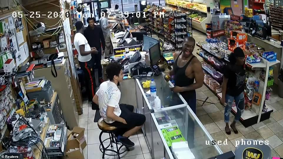 New video showing George Floyd (center in a black tank top) inside the Minneapolis Cup Foods store moments before his death was played in court on Wednesday at the start of day three of Derek Chauvin's murder trial