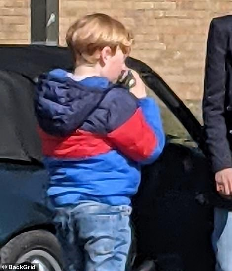 Just like him: The actor portraying the youngest Prince donned a brighter cobalt blue jacket and jeans