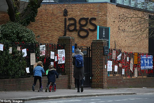 A former pupil at JAGS (placards outside the school, pictured) revealed herself to be the co-author of a letter making allegations against Dulwich College pupils