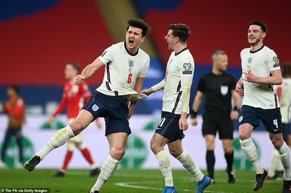 Harry Maguire celebrates scoring a late winner to help England overcome Poland in their 2022 World Cup qualifier