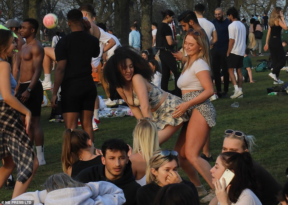 Girls were seen dancing in Hyde Park in Leeds as outdoor celebrations continued into the evening yesterday