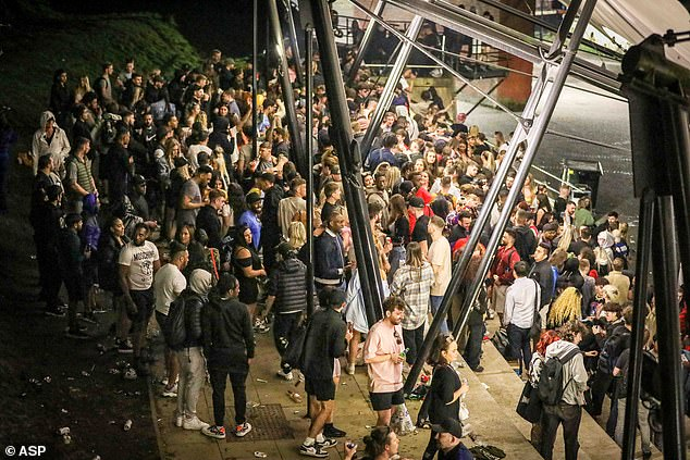 =Hundreds of revelers attended a 'rave' this evening in Manchester City Centre. The revelers were seen gathering in the Castlefield Bowl area