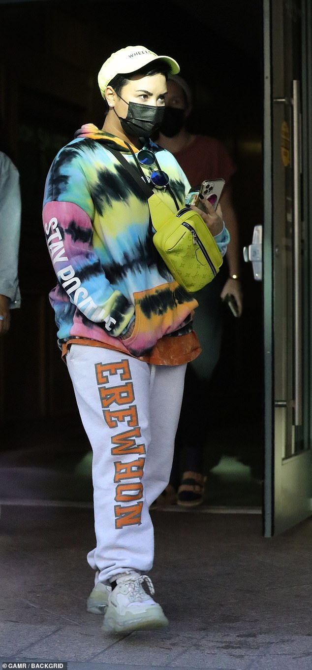 Eye-catching outfit: Demi Lovato was unmissable in a colorful tie dye hoodie as she stepped out in Beverly Hills on Wednesday