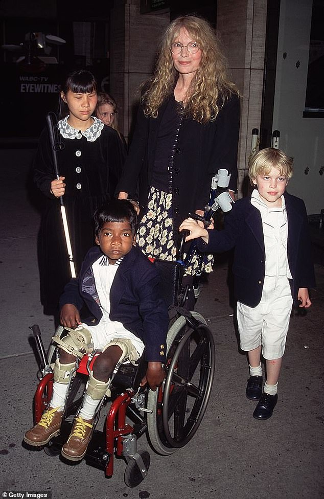 Tam Farrow, with a cane, is seen in 1995, with Thaddeus. Shepassed away in 2000 at age 19