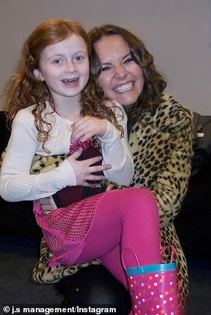 Say cheese: Julia also posted a photo with little Maisie with Charlie Brooks (Janine Butcher)