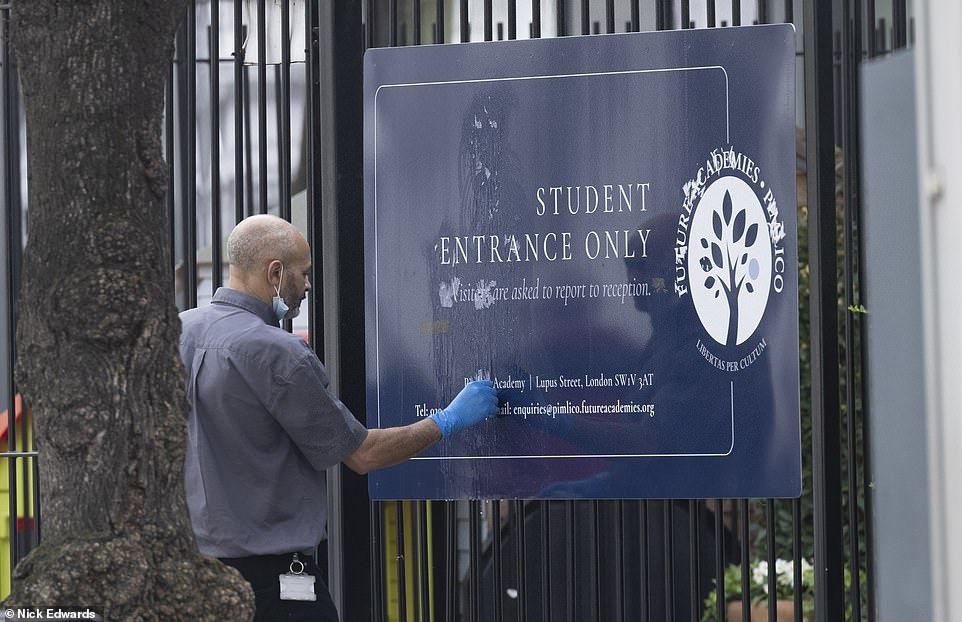 The sign outside the school, which was defaced with stickers during yesterday's protest, was cleaned up this morning