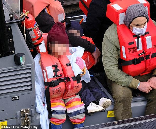 Border Force vessel Vigilant was seen unloading migrants shortly after 12pm at Dover Marina, Kent, despite the30mph winds
