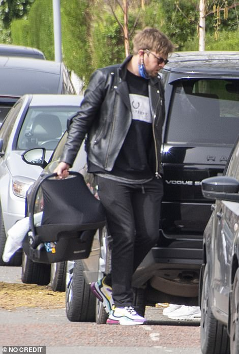Casually-clad: Iain cut a casual figure in a black leather jacket