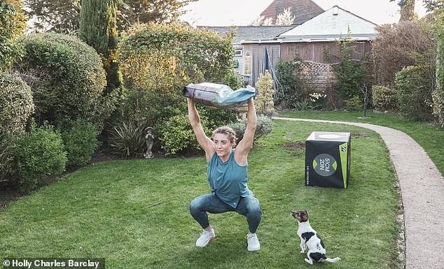 Lucy (pictured) and her husband Reece train in her father-in-law's garden, where a 'pain cave' has been set up with workout machines