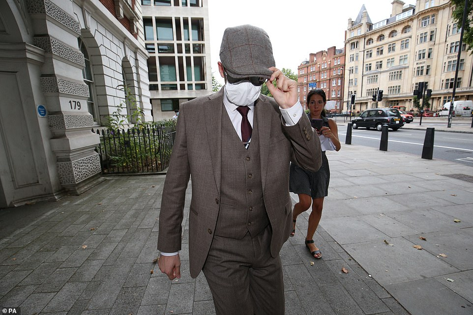 Hannam pictured leaving Westminster Magistrates' Court in London in August ahead of the three-week trial