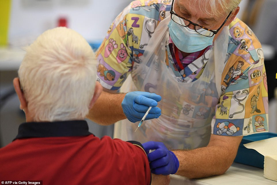 Pfizer's vaccine has been given to around 11million people in the UK and is a staple of the rollout, balanced with AstraZeneca jabs (Pictured: A man receives the vaccine in Derby)