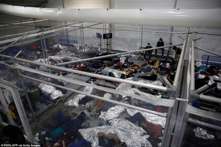 Media were allowed in to see the border facilities on Texas this week, with shocking scenes like the one above at the Donna Department of Homeland Security holding facility (file photo)