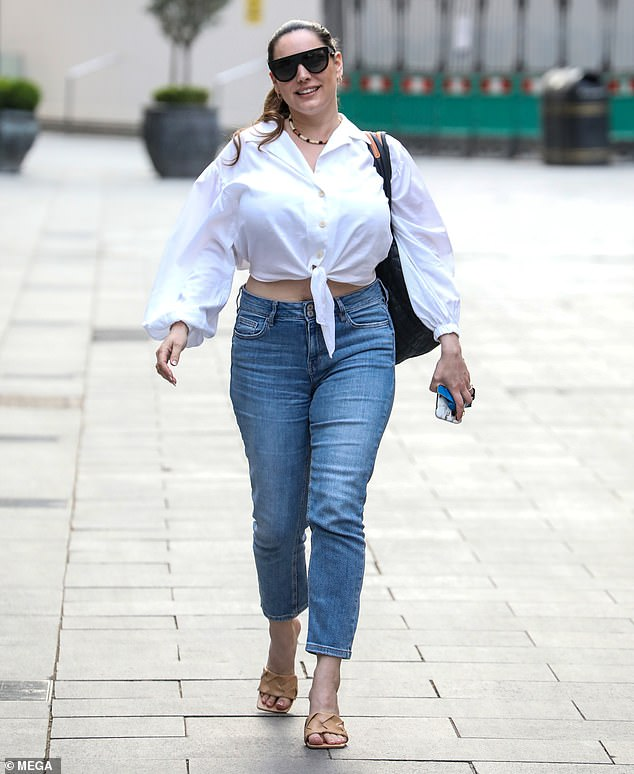 Dressed to impress:The brunette beauty teamed the top with blue cut-off jeans and nude peep-toe heels, and carried her essentials in a black leather off-the-shoulder bag